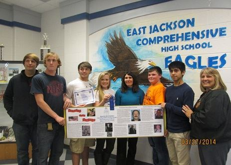 High school students with poster
